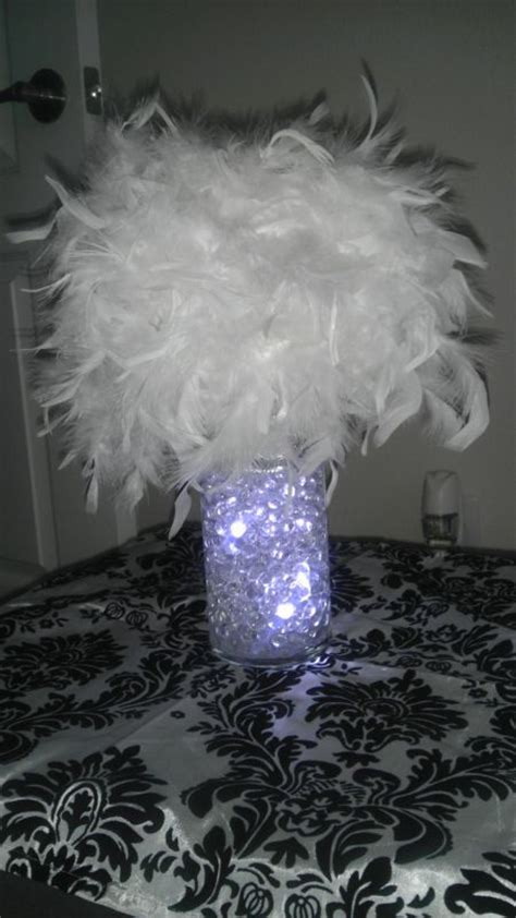 feathers for centerpieces my diy feather centerpiece weddingbee photo gallery