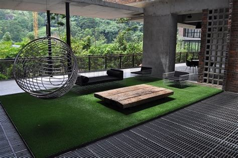 outdoor grass rugs a green space with an artificial grass rug