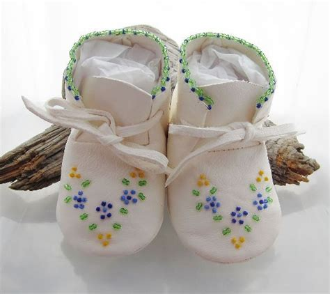 beaded moccasins and beaded baby moccasins and soft soled shoes made of soft