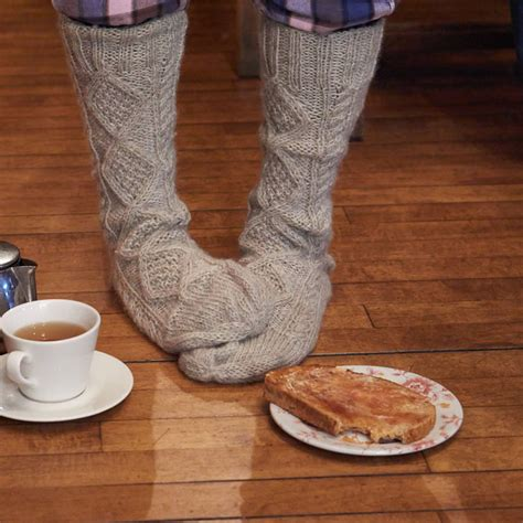 aran sock knitting pattern cosy aran knitted socks by bibico notonthehighstreet