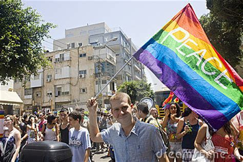parade ta blond youth with peace flag at pride parade ta editorial