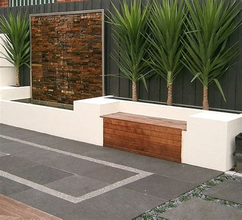 garden feature wall ideas bench seat along house brick wall this water