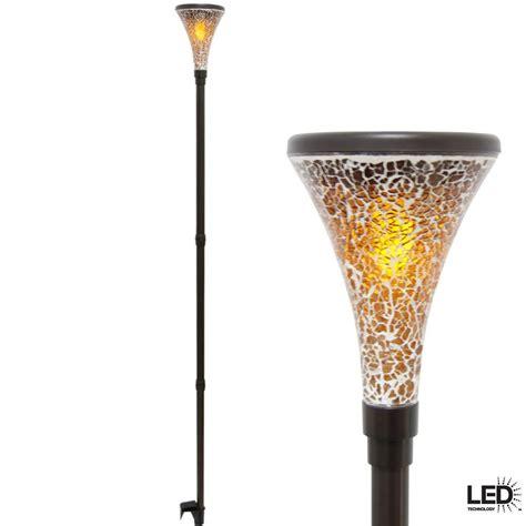 solar tiki lights hton bay solar tiki brown outdoor light with