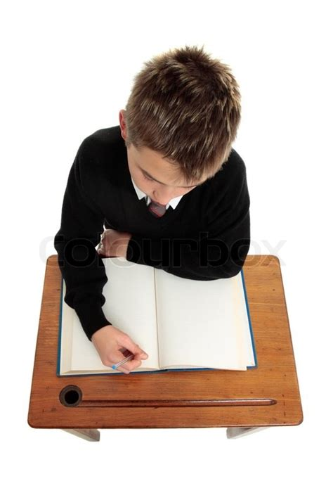 student at desk conscientious school boy student sitting at a desk with an