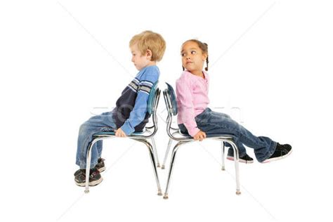 Behaviour Modification Of A Child by Two Children Sitting Back To Back Stock Photo 169 Suzanne