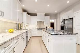white kitchen cabinets gray granite countertops white kitchen with gray glass backsplash and granite