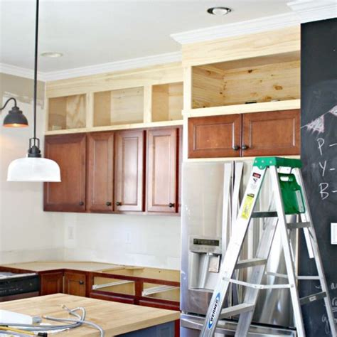 ideas for space above kitchen cabinets thrifty decor kitchen makeover fixing that annoying space above your cabinets kitchens