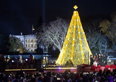 obama lights up national tree appeals to