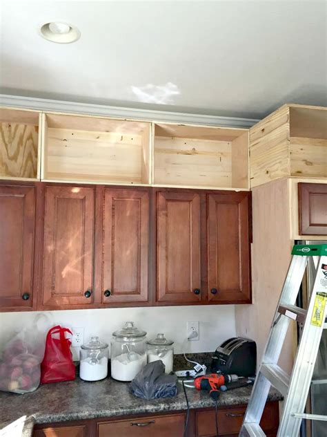 add shelves to cabinets building cabinets up to the ceiling from thrifty decor