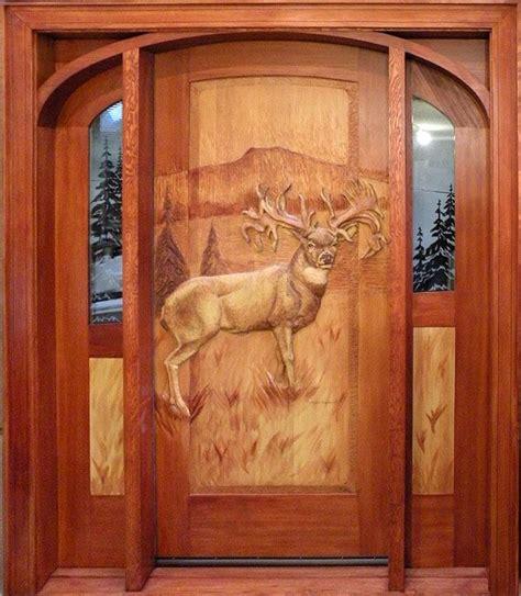 carved front doors handcarved mule deer on wooden door photo via web