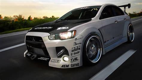 Car Evolution Wallpaper by Mitsubishi Lancer Evolution On The Road Wallpaper Car