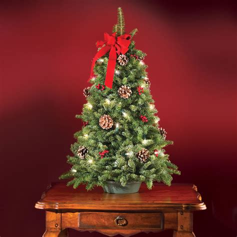 artificial tabletop trees the freshly cut prelit tabletop tree hammacher schlemmer