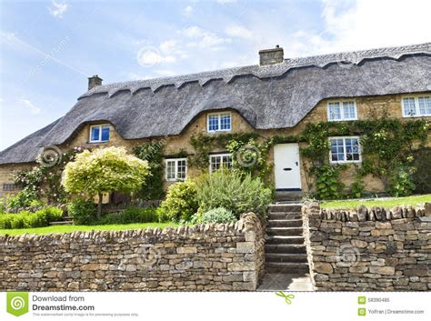 traditional cottage garden flowers thatched cottage with flowers wall stock