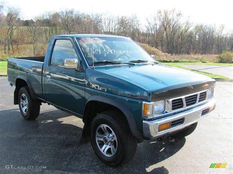 Nissan 4x4 Truck 1997 teal pearl metallic nissan hardbody truck xe