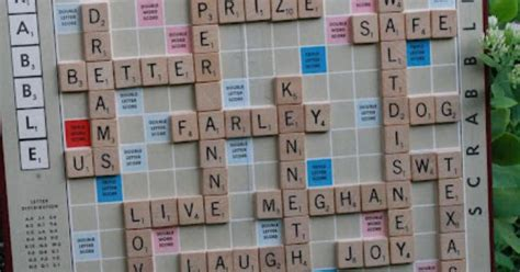 create a scrabble board glue scrabble letters to board using words that