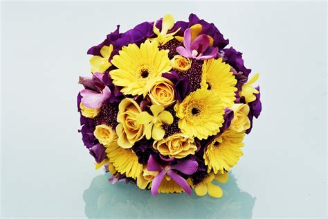 purple and yellow wedding centerpieces wedding flowers wedding flowers yellow and purple