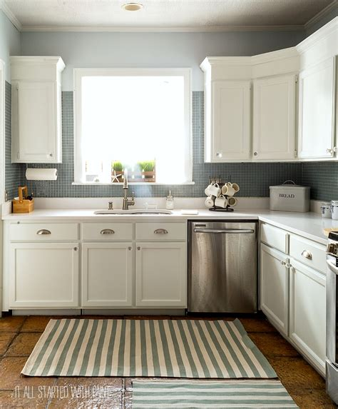 white painted kitchen cabinets how to paint builder grade cabinets