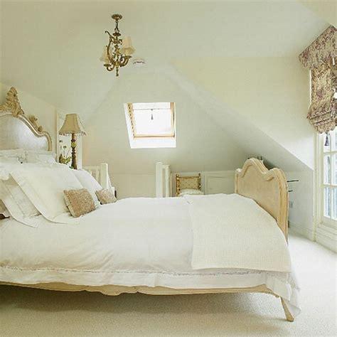 bedroom chandeliers uk neutral loft bedroom with antique bed and chandelier