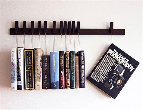 pictures of book racks hanging book rack hang em and read em technabob