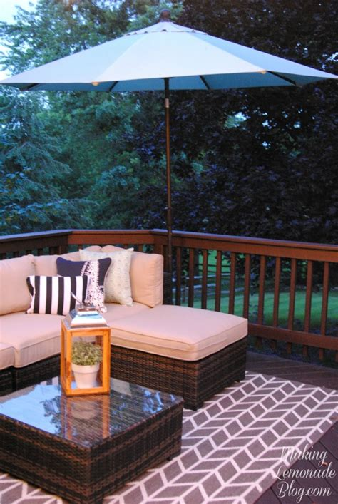 cheap patio string lights how to hang outdoor string lights the deck diaries part