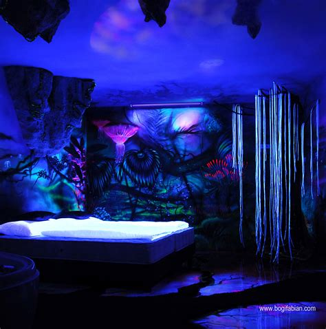 blacklight painting artist paints rooms with murals that glow blacklight