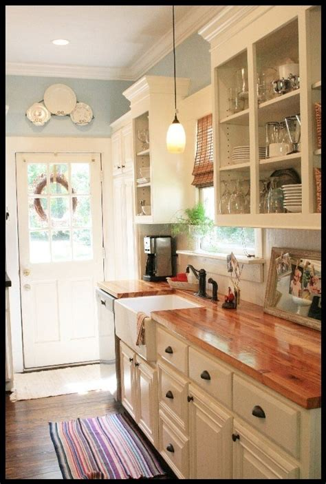 white kitchen cabinets with butcher block countertops white cabinets butcher block countertops and pretty blue