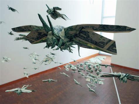 flying origami sipho mabona s swarm of flying money origami locusts yatzer