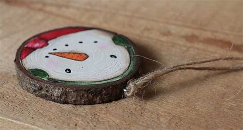 country snowman ornaments country snowman with earmuffs painted wood slice