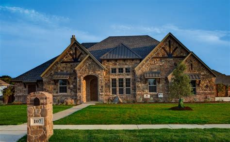 custom home designers bailee custom homes rustic exterior dallas by q home designs