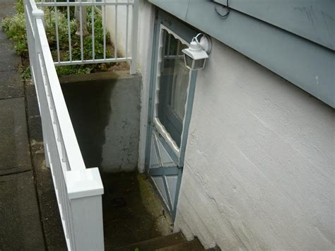 outdoor basement doors drain preventing clogging flooding at bottom of exterior