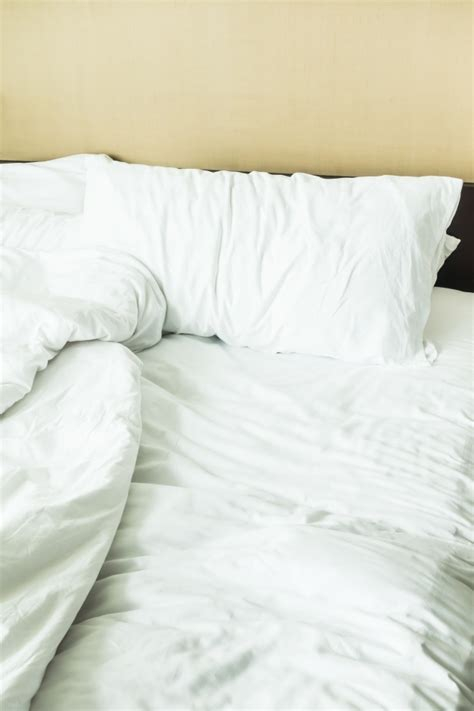 up bed up of bed with creased sheets photo free