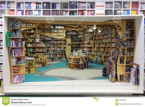 picture books about toys books and toys on shelves in a bookstore editorial image