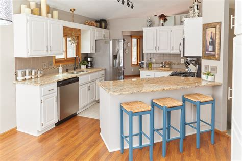 what is the best way to paint kitchen cabinets white the best way to paint your kitchen cabinets