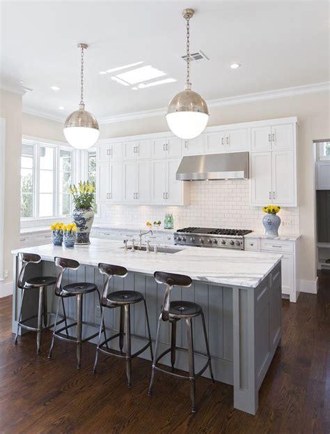 white kitchen with island hallie henley design the contrast of darker floors