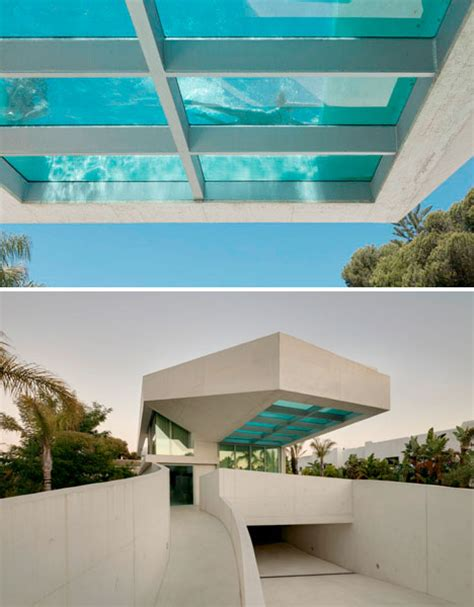 House Plans With Bedrooms In Basement by Jellyfish House Cantilevered Rooftop Pool With Glass Floor