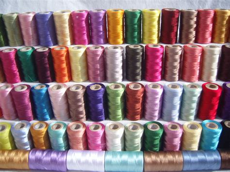 threads and 50 spools of sewing machine silk embroidery threads