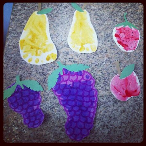 fruit crafts for some handprint and footprint food made for a picnic theme