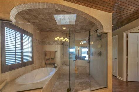 Rustic Master Bathroom With Hardwood Floors Amp High Ceiling