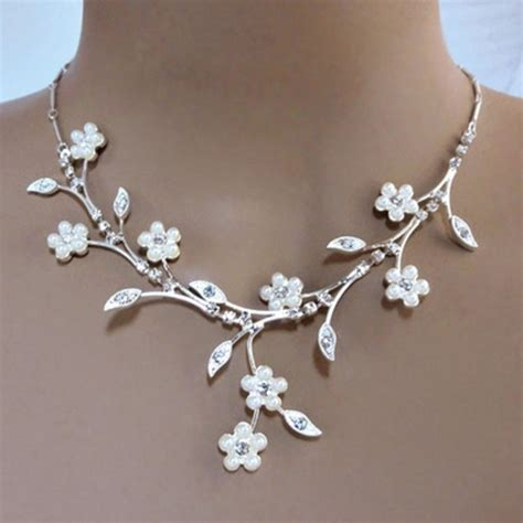 pearl for jewelry faux pearl white flowers adorn elaborate rhinestone