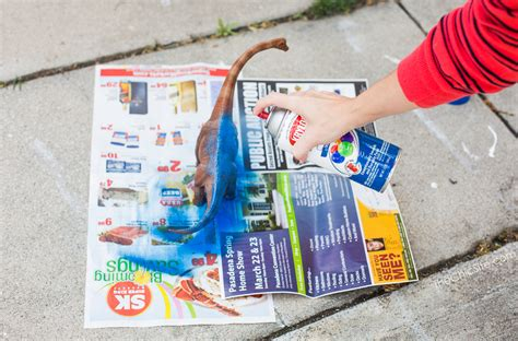 spray paint newspaper dinosaur toilet paper holder the chic site
