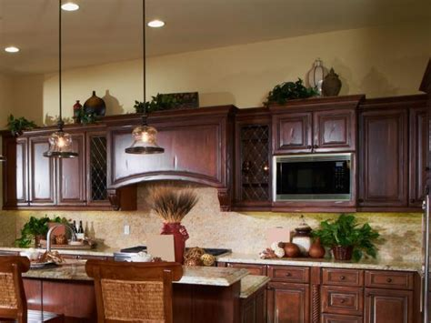decorating above kitchen cabinets ideas ideas for decorating above kitchen cabinets lovetoknow