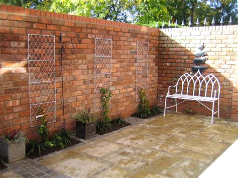 brick walls for gardens reclaimed brick walls in a small courtyard garden from a
