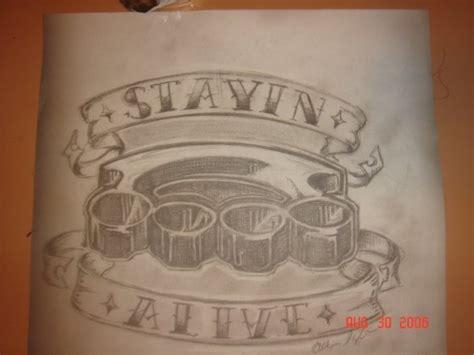 brass knuckles tattoo design by dmvcustomdesign on deviantart
