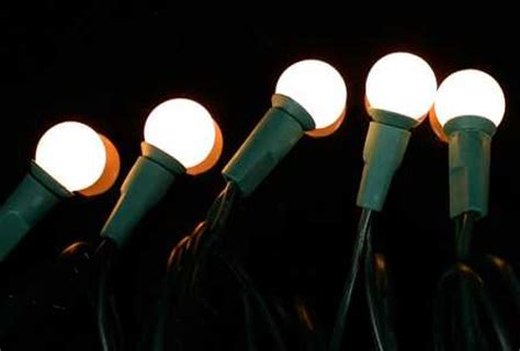 pearl lights string of 35 8mm pearl white globe bulb lights on green