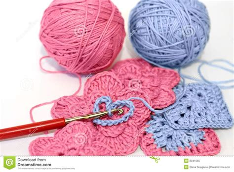 crocheting with crocheting project with pink and blue yarn stock image