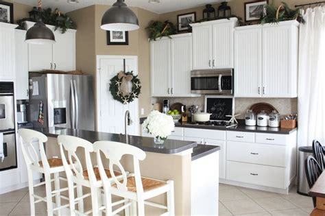 above kitchen cabinets ideas greenery above kitchen cabinets ideas in white painted cabinets decolover net