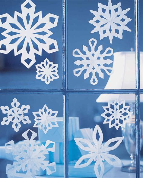 paper snowflake decorations how to make paper snowflakes martha stewart