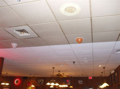 spray painting drop ceiling tiles the benefits of spray painting suspended ceilings with