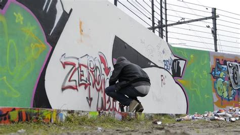 spray painter looking for work graffiti artist being disturbed during spray painting