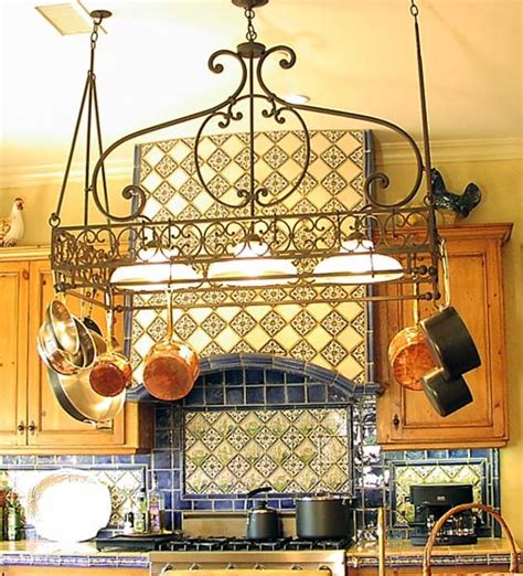 kitchen island with pot rack kitchen lighting mediterranean kitchen los angeles by steven handelman studios